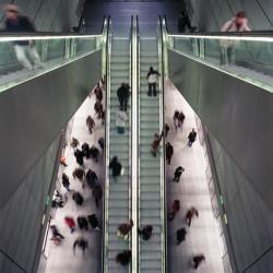 Passengers using escalators in a metro station