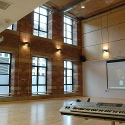 Studio 3 with a projector playing a film and a keyboard set up